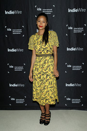 Thandie Newton paired her dress with black multi-strap pumps by Christian Louboutin.