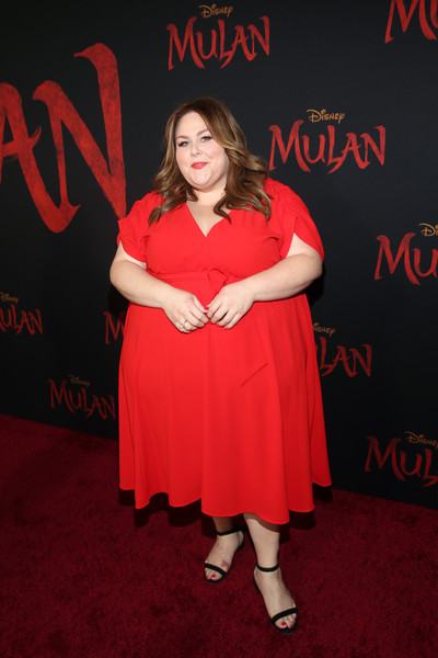 Chrissy Metz opted for a simple red midi dress when she attended the world premiere of 'Mulan.'