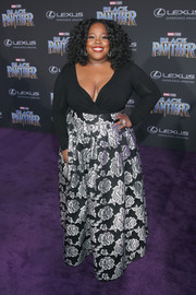 Amber Riley showed some skin in a deep-V sweater at the world premiere of 'Black Panther.'