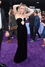 Miley Cyrus went for flirty glamour in a strapless Saint Laurent velvet gown with a front cutout at the world premiere of 'Avengers: Endgame.'