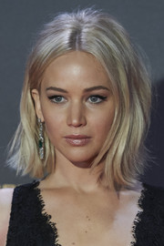 Jennifer Lawrence channeled the '60s with this teased, center-parted flip at the Madrid premiere of 'The Hunger Games: Mockingjay Part 2.'