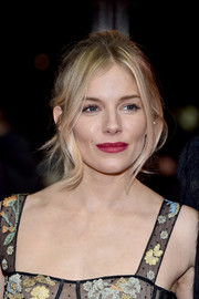 Sienna Miller played up her lips with a rich berry hue.
