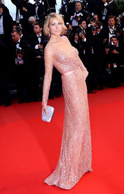 Petra Nemcova's lovely blush-colored long-sleeve beaded gown looked simply elegant on the model.