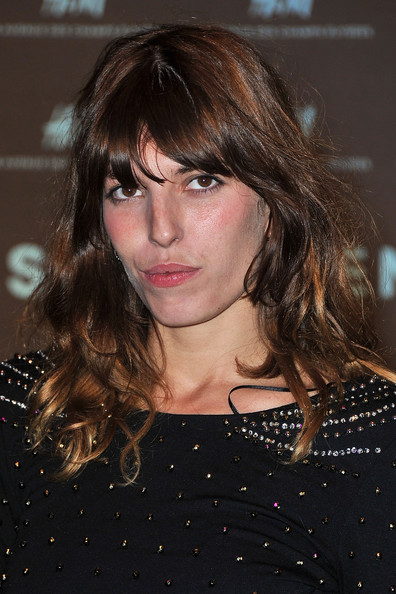 Lou Doillon Long Wavy Cut with Bangs [hair,hairstyle,face,bangs,brown hair,eyebrow,beauty,layered hair,chin,long hair,jean nouvel,lou doillon,flagship,paris,france,champs elysees,h m,red carpet,pfw spring,paris fashion week spring]