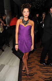Erin wears a hot purple cocktail dress with unique pleating for the Louis Vuitton collection launch.