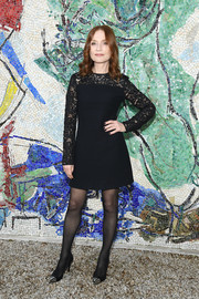 Isabelle Huppert was classic in a lace-panel LBD by Louis Vuitton during the label's Cruise 2019 show.