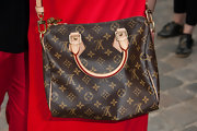 Kaya Scodelario attended the Louis Vuitton fashion show carrying, what else, an LV cross-body tote.
