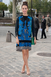 Berenice Bejo layered prints for the Louis Vuitton show in Paris.