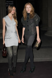 Lily Cole attended the Louis Vuitton Art Talk wearing green and black brogues with a dark outfit.