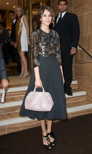 The always stylish Alexa Chung paired her Louis Vuitton ensemble with an LV handbag.