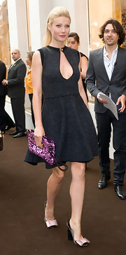 Gwyneth Paltrow hit the Louise Vuitton party looking very chic. She toted around a vibrant purple sequin clutch.