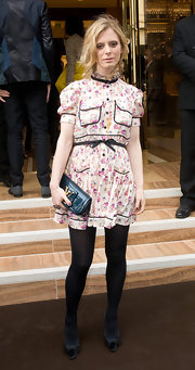 Emilia Fox looked darling in her floral print dress. She paired her ensemble with black tights and peep toe pumps.