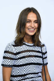 Alicia Vikander styled her hair with barely-there waves for the Louis Vuitton boutique opening in Paris.