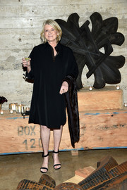 Martha Stewart donned a simple black tunic dress for the Louis Vuitton dinner.