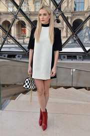 Riley Keough's red Louis Vuitton ankle boots worked beautifully with her monochrome frock.