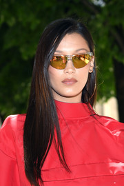 Bella Hadid amped up the cool factor with a pair of gold shield sunglasses.