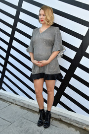 Lea Seydoux dressed up her baby bump in a silver and black Louis Vuitton mini dress for the label's Spring 2017 show.