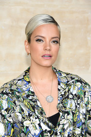 Lily Allen flaunted a sleek French twist at the Louis Vuitton Menswear Spring 2018 show.