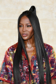 Naomi Campbell sported a samurai-inspired half-up style at the Louis Vuitton Menswear Spring 2018 show.