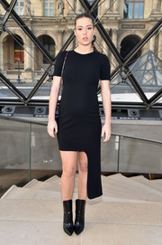 Adele Exarchopoulos rocked a black side-mullet maternity dress by Louis Vuitton during the label's fashion show.