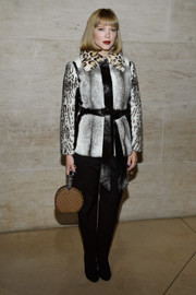 Lea Seydoux got glam in a gray Louis Vuitton fur jacket with a leopard-print collar and sleeves for the brand's Spring 2018 show.