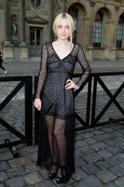 Dakota Fanning looked subtly sexy and totally elegant in a sheer black lace-overlay dress during the Louis Vuitton fashion show.