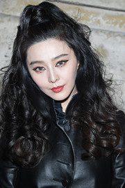 Fan Bingbing looked ultra feminine with her high-volume half-up curls at the Louis Vuitton Fall 2018 show.
