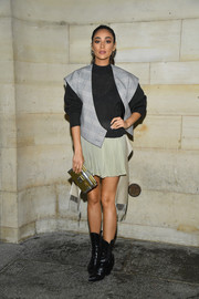 Shay Mitchell stayed cozy in a charcoal sweater by Louis Vuitton during the brand's Spring 2019 show.