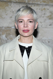 Michelle Williams stuck to her trademark pixie when she attended the Louis Vuitton Fall 2018 show.