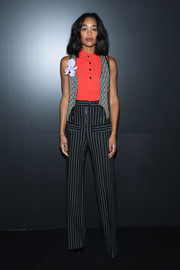 Laura Harrier finished off her cool ensemble with a pair of pinstriped pants, also by Louis Vuitton.