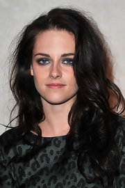 Kristen Stewart used dark blue-gray shadows to create her smoky-eyed look for fashion week in Paris.
