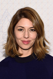 Sofia Coppola topped off her look with a lovely wavy style when she attended the Louis Vuitton Monogram celebration.