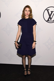 Sofia Coppola teamed her frock with a pair of double-strap pumps by Louis Vuitton.