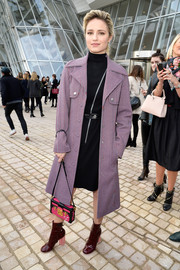 Dianna Agron added a retro touch with a pair of chunky-heeled burgundy boots, also by Louis Vuitton.