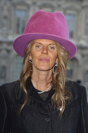 Anna dello Russo topped off her look with a funky oversized fucshia hat by Pierre Cardin when she attended the Louis Vuitton fashion show.