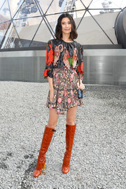 Tao Okamoto was breezy and boho in a Louis Vuitton mixed-print mini dress during the label's fashion show.