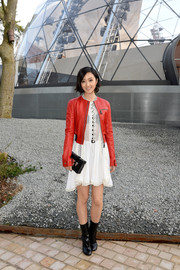Gwei lun Mei attended the Louis Vuitton fashion show wearing a chic red leather jacket over a little white dress.