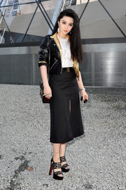 For her footwear, Fan Bingbing chose a retro-chic pair of black Louboutin platform sandals with laser-cut straps.