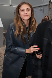 Elisa Sednaoui attended the Louis Vuitton fall 2012 fashion show wearing a shiny tomato-red nail polish.