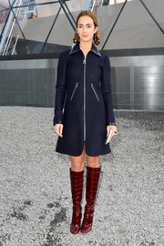 Alexia Niedzielski channeled the '60s in a blue A-line wool coat during the Louis Vuitton fashion show.