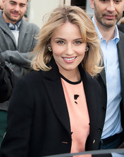 Dianna Agron attended the Louis Vuitton fall 2012 fashion show wearing a soft peachy-pink lipstick.