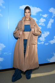 Bella Hadid covered up in a bulky tan wool coat by Louis Vuitton for the label's Menswear Fall 2020 show.