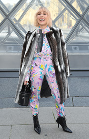 Noomi Rapace arrived for the Louis Vuitton Fall 2019 show wearing a luxurious fur coat.