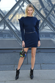 Karlie Kloss looked cool and cute in a pointy-shouldered navy mini dress at the Louis Vuitton Fall 2019 show.