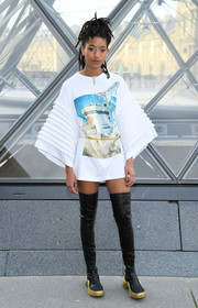 Willow Smith attended the Louis Vuitton Fall 2019 show wearing a graphic mini dress with oversized sleeves.