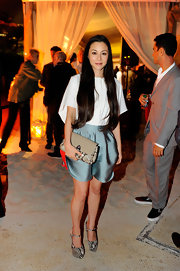 China Chow was simply chic at the Louis Vuitton soiree in Miami Beach in snakeskin platform pumps.