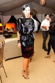Wendy Deng topped off her sequined party frock with subtle black strappy sandals and layered bracelets.