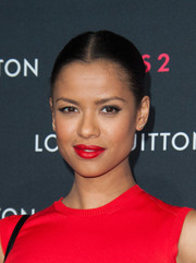 Gugu Mbatha-Raw chose a bold red lip color to match her dress.