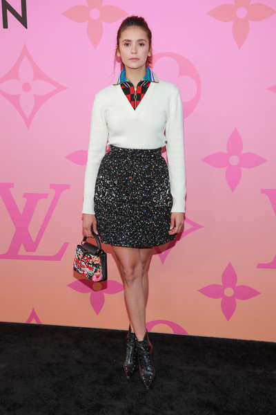 Nina Dobrev dressed up her sporty top with a beaded mini skirt.