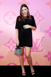 Miranda Kerr kept it relaxed in a short black maternity dress with a colorful yoke at the Louis Vuitton X: An Immersive Journey event.